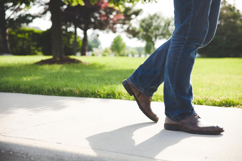 walking, sidewalk, shoes, jeans, pants, people, grass, people