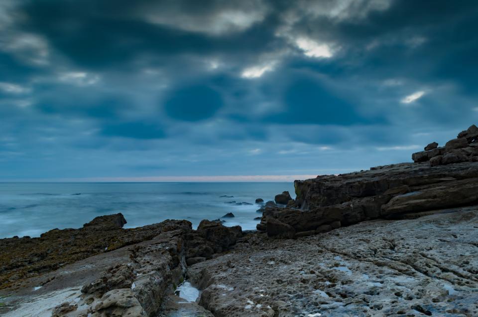 ocean, sea, water, coast, shore, storm, clouds, cloudy, sky, horizon, rocks, boulders, landscape, nature