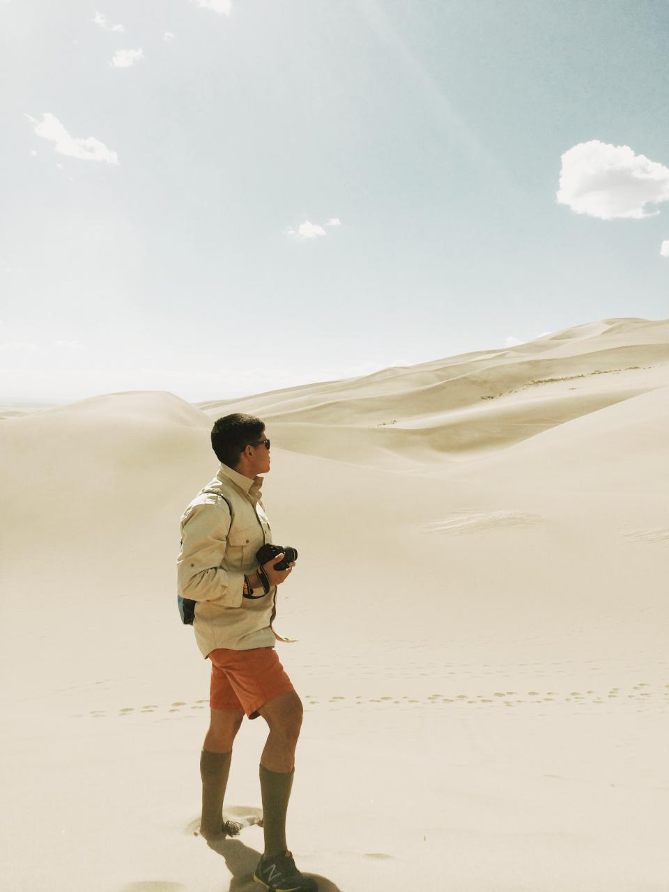 guy, man, sand, dunes, desert, shorts, camera, photographer, sunshine, blue, sky
