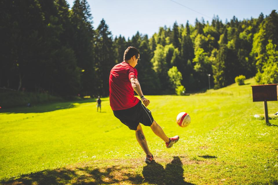 guy, man, male, play, football, soccer, kick, ball, park, grass, signage, trees, nature, sky