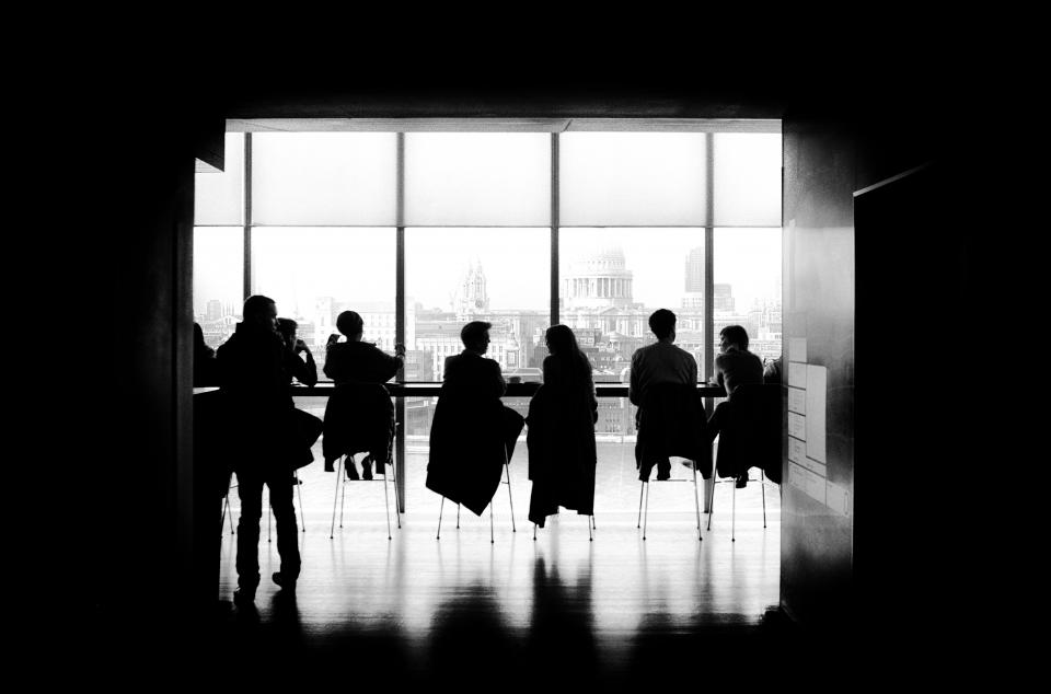 people, men, girls, sitting, talking, high chairs, business, black and white, building, silhouette