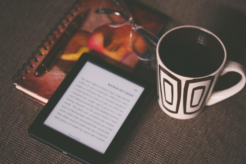 kindle, e-reader, technology, reading, book, objects, coffee, cup, mug, notebook, notepad, pen, eyeglasses, business