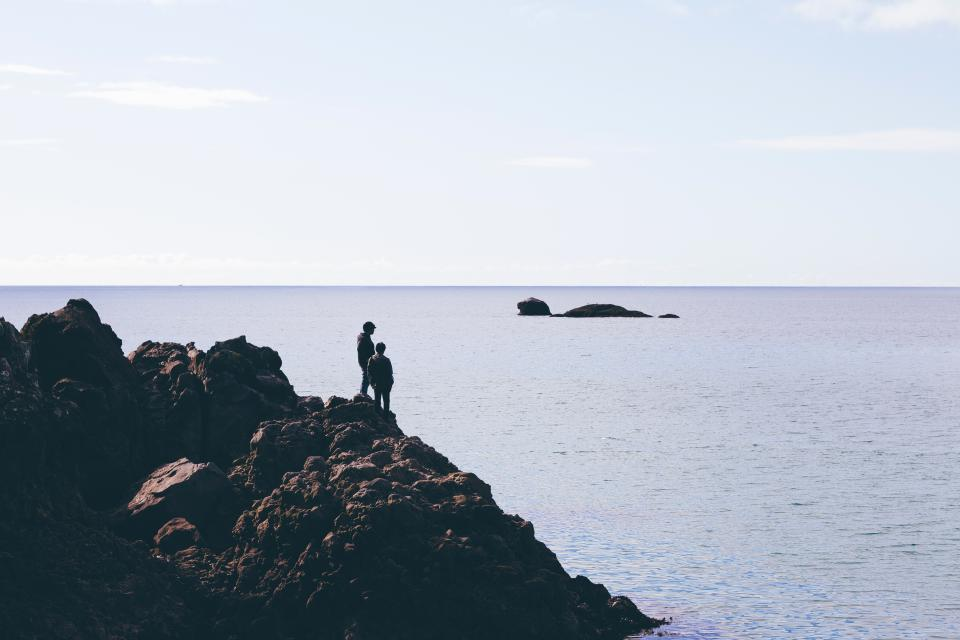 people, hiking, trekking, adventure, coast, rocks, cliff, ocean, sea, horizon, water, sky, nature, landscape, sunshine, blue
