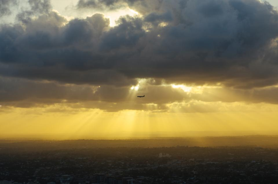 sunbeams, clouds, airplane, flying, travel, transportation, sunrise, dawn, cloudy