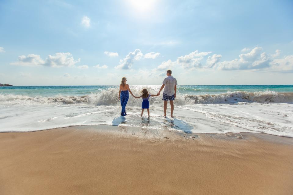 people, family, woman, man, mother, father, kid, girl, baby, child, beach, sea, water, ocean, vacation, summer, sunny, sky, clouds, waves