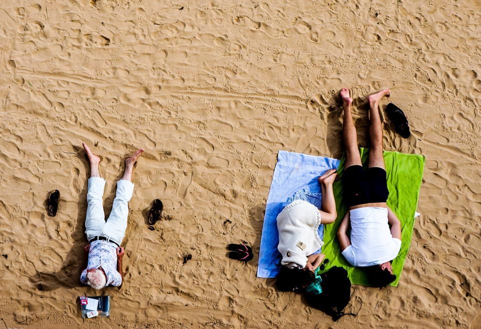 beach, sand, people, girl, guy, man, elderly, senior, relaxing, lying down, sleeping, towel, sandals