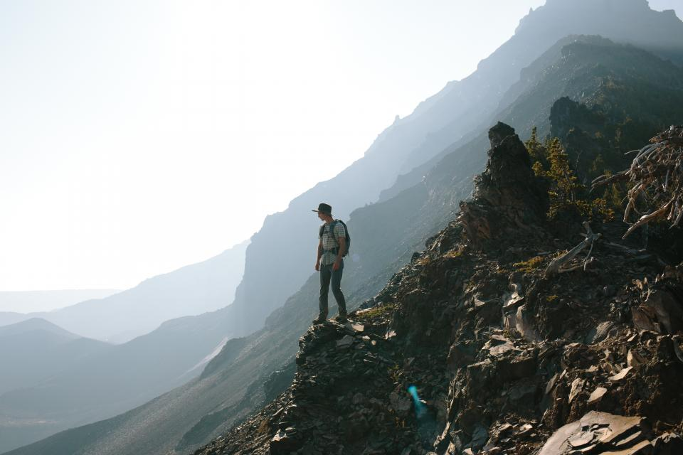 hiking, trekking, mountains, cliffs, nature, outdoors, adventure, guy, man, people, backpack, landscape