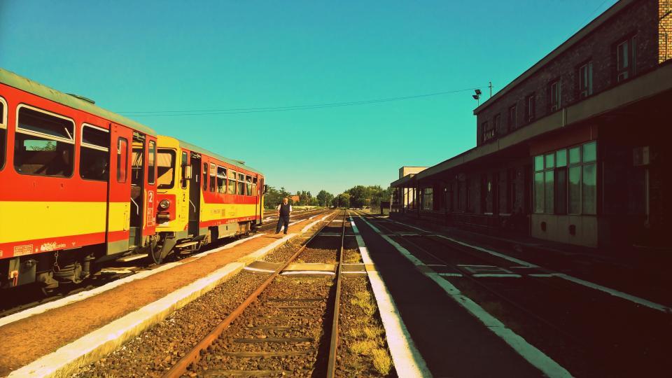 railroad, railway, train, station, transportation, sunshine, sky, buildings, city, town
